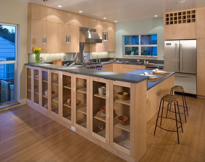 Kitchen island in creamy color and with the storage shelving