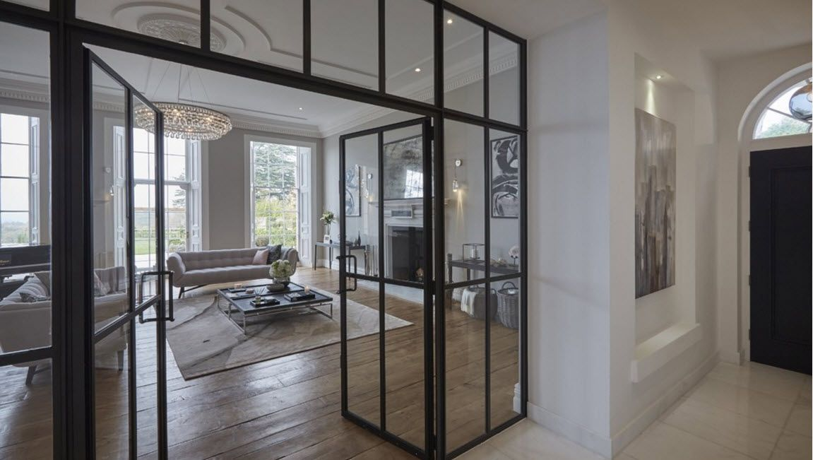All the glass doors in the steel black frame look spectacular in the studio apartment