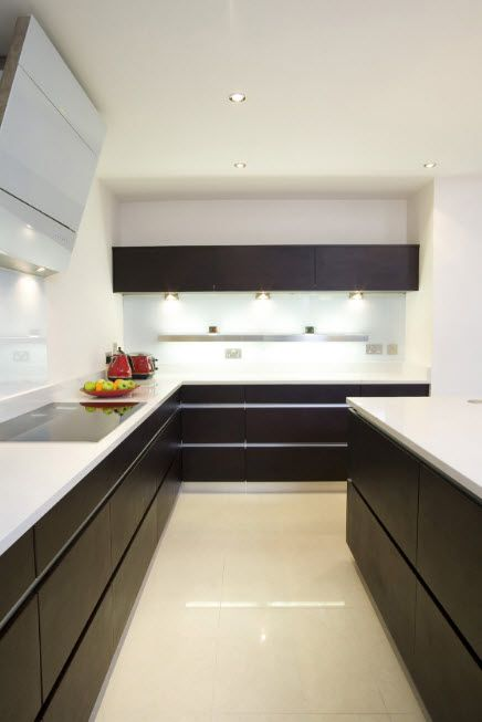 Wenge Color Modern Interior Design Ideas. Angular kitchen with dark facades of the lower tier