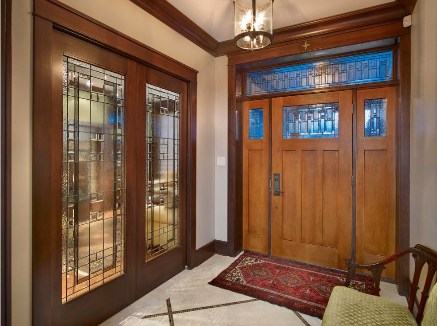 Glass incrusted entrance door of solid wood