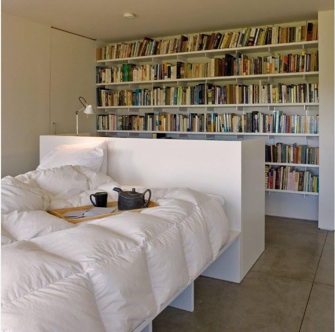Shelving as Zoning Element & Storage for Modern Interior. Library zone in the modern set bedroom