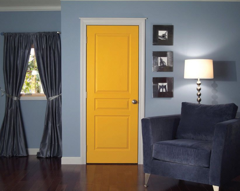 Contrasting yellow doors in the blue decorated interior