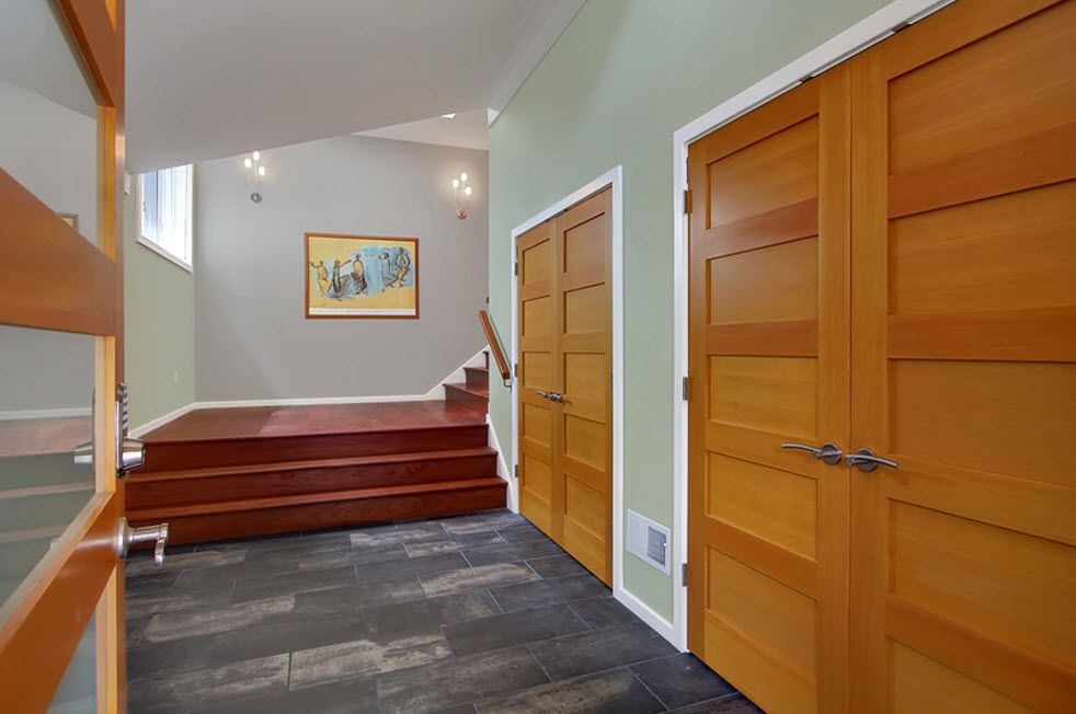 Interior Doors. Essential Element of Modern Apartment. Light wooden doors for modern styled hallway