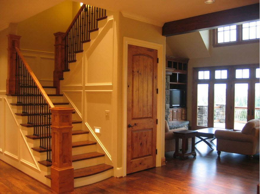 Stairs space with the wooden interior door