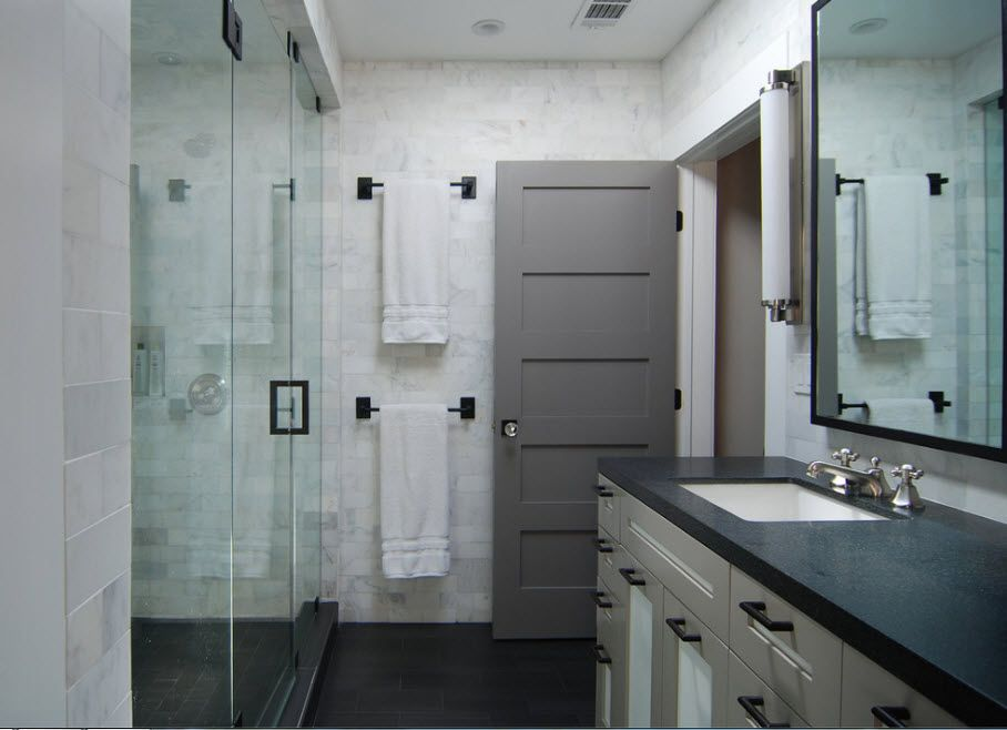 Interior Doors. Essential Element of Modern Apartment. Dark gray entrance zone of the large bathroom