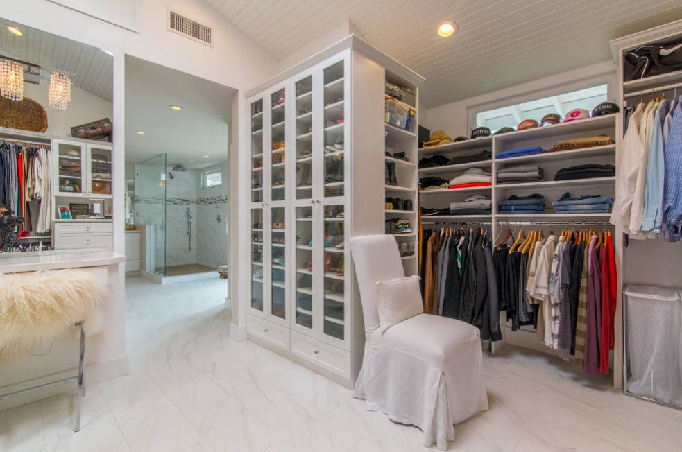 Shelving as Zoning Element & Storage for Modern Interior. Wardrobe with wooden glass panelled rack