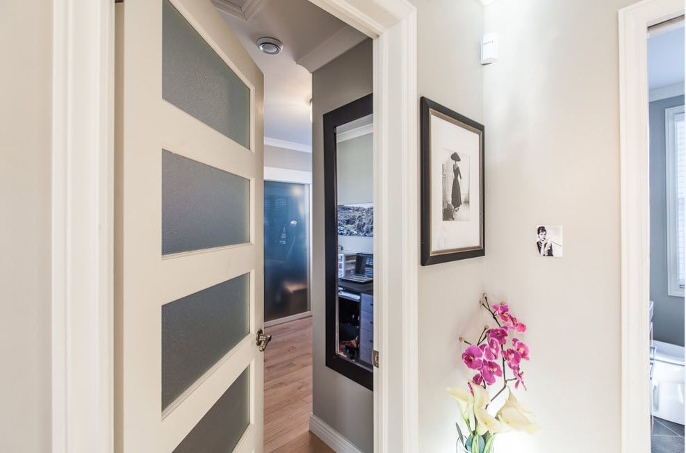 Modern style of glass inlays in the light colored interior doors