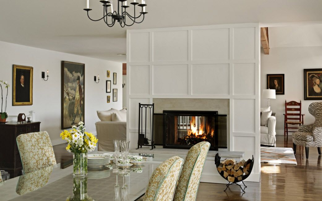 White accent panelled wall with the fireplace