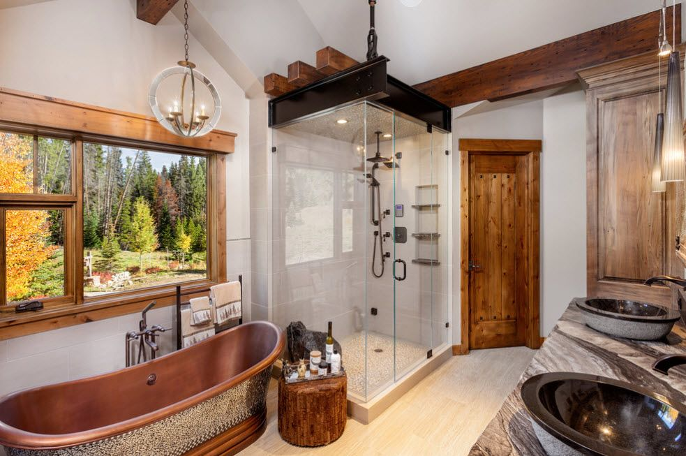 Gorgoeus execution of Rustic style in modern bathroom with ceramic imitating bathtub, glass shower cabin