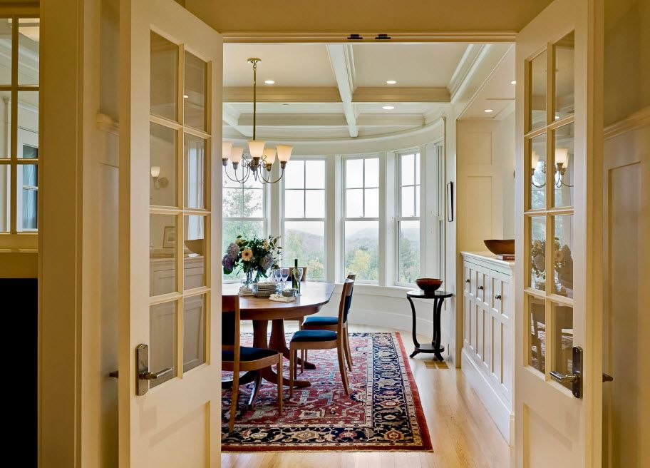 Classic interior with neat wooden doors with latticed glass windows