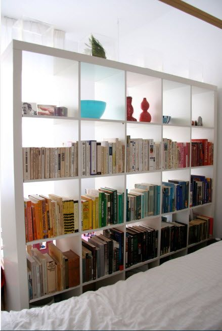 Shelving as Zoning Element & Storage for Modern Interior. Whole grid of small shelves