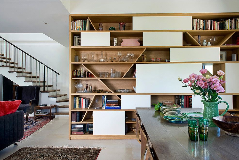 Shelving as Zoning Element & Storage for Modern Interior. Classy design with combined open/closed segments