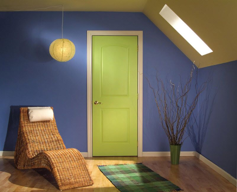 Interior Doors. Essential Element of Modern Apartment. Green fibreboard door along with blue painted wall