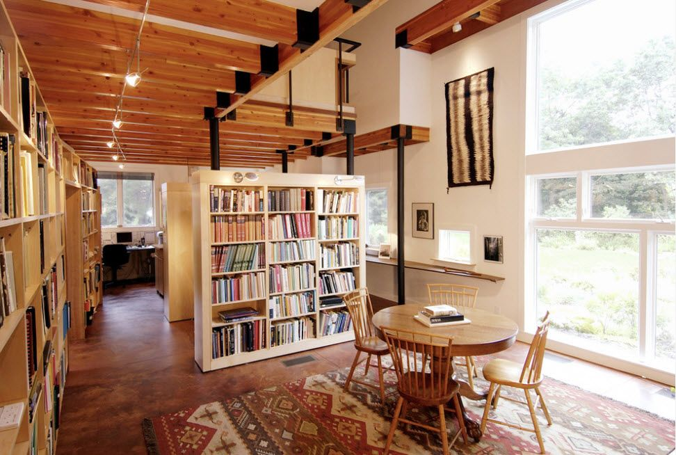 Shelving as Zoning Element & Storage for Modern Interior. Open light wooden beams for large private house's living with dining zone