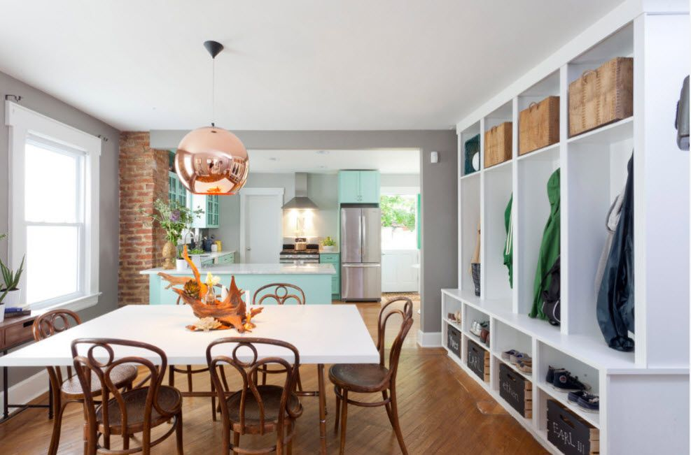 Shelving as Zoning Element & Storage for Modern Interior. Hanging right in the dining room