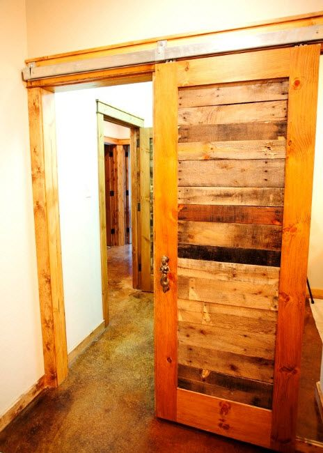 Interior Doors. Essential Element of Modern Apartment. Wooden rustic styled sliding door with top guide