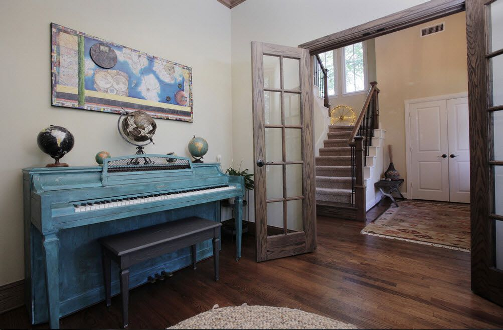 Hall zoned by a swinging doors from the stairs in Classic interior
