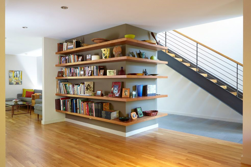 Shelving as Zoning Element & Storage for Modern Interior. Wall partition with wooden shelves