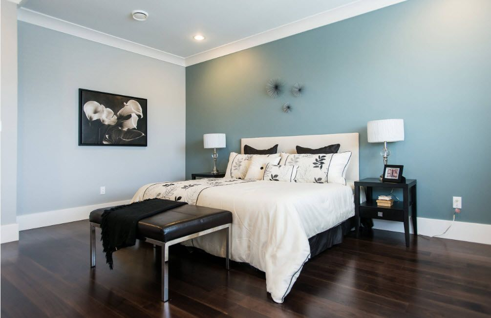 Dark olive accent wall painting and the wenge decoration of the modern bedroom