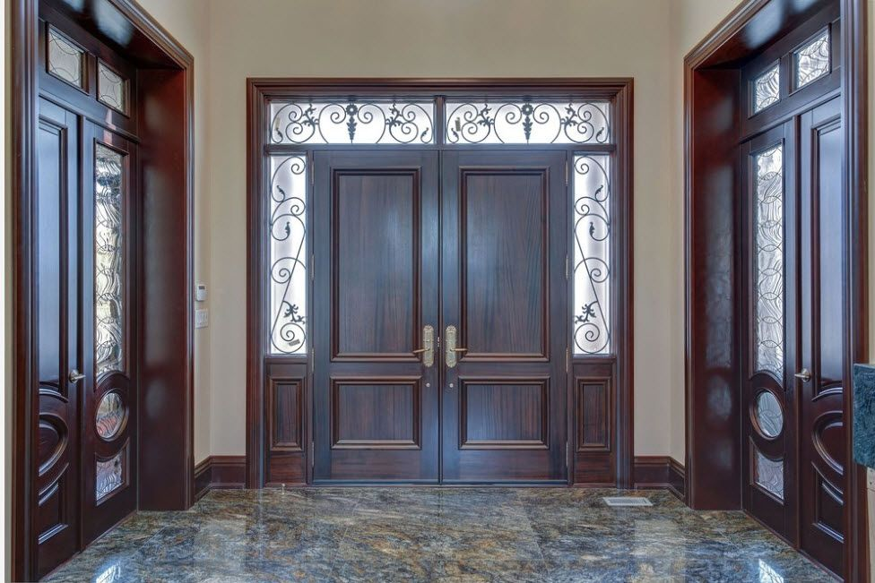 Interior Doors. Essential Element of Modern Apartment. Complex wooden construction with transom and lites