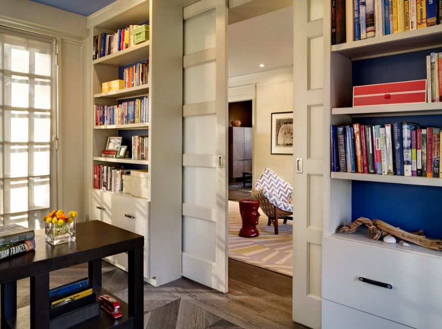 Interior Doors. Essential Element of Modern Apartment. Private library with sliding doors