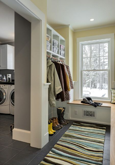 Classic styled mud room with  hanger and small shelves at the top