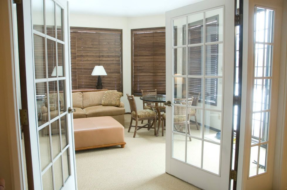 Interior Doors. Essential Element of Modern Apartment. Standard glass latticed white wooden doors