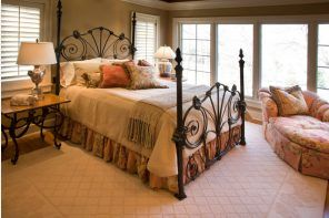 Wrought-iron Bed as a Stylish and Functional Interior Element. Classic forms for the bed frame