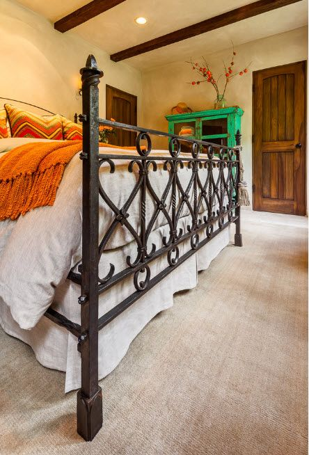 Wrought-iron Bed as a Stylish and Functional Interior Element. The frame is reminiscent of metal fence