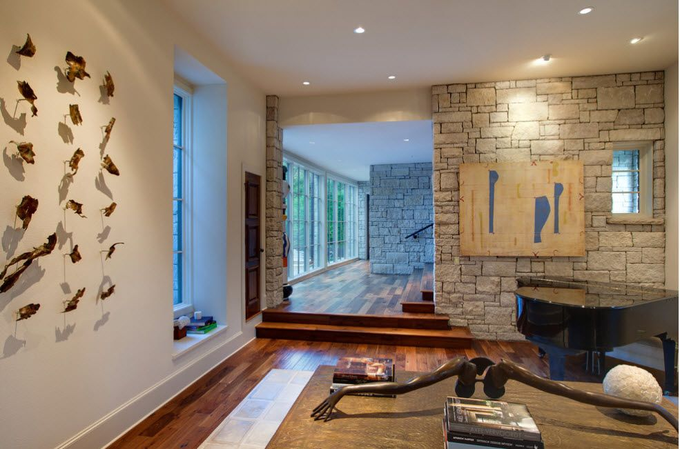 Accent wall in the Modern living room finished with artificial stone