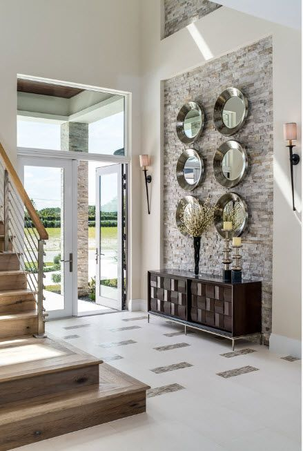 The Use of Decorative Stone for Modern Interiors' Finishing. Plates decorated hall with gray accent wall