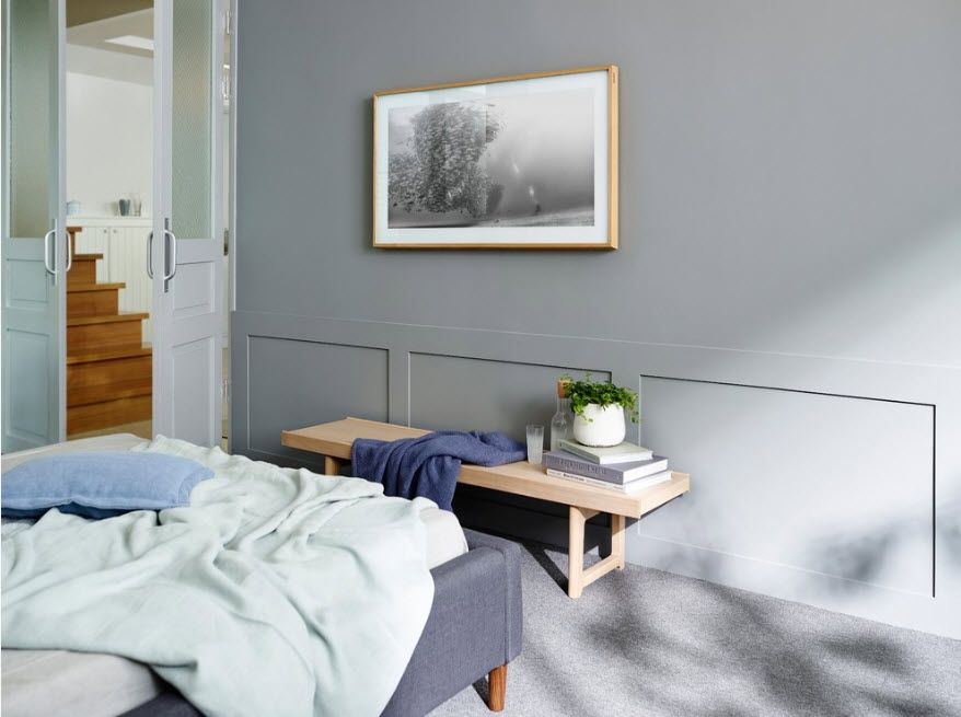 Gray accent wall in the minimalistic bedroom atmosphere