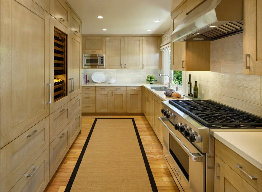 Bleached Oak Color in Modern Interior Design. Angular kitchen design with light wooden furniture facades