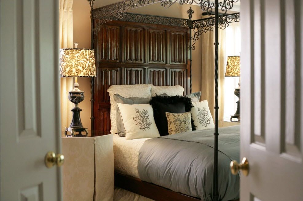 Wrought-iron Bed as a Stylish and Functional Interior Element. Royal bed in the Classic atmosphere with wooden dorr imitating at the headboard