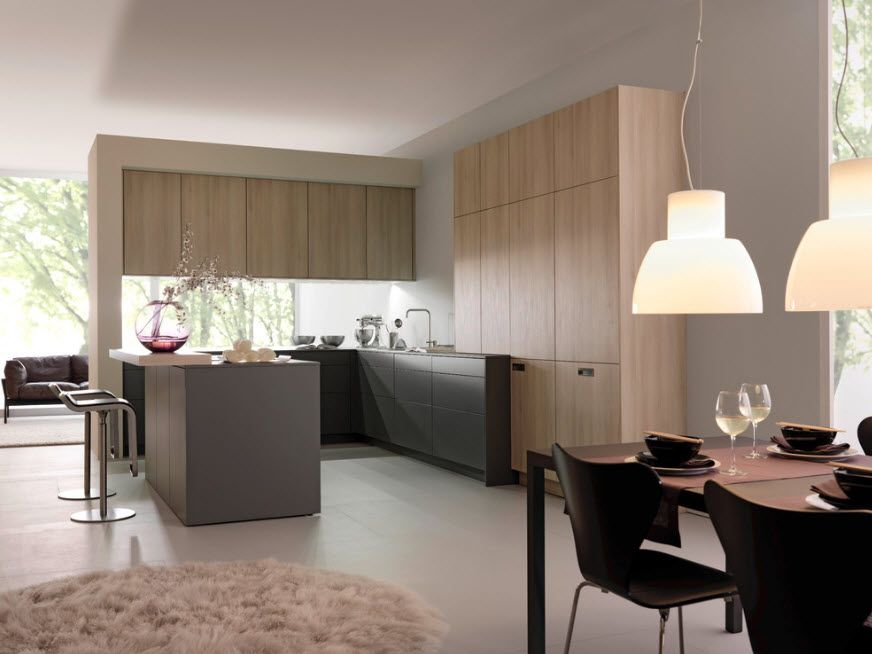 Bleached Oak Color in Modern Interior Design. Angular kitchen design with light wooden furniture facades