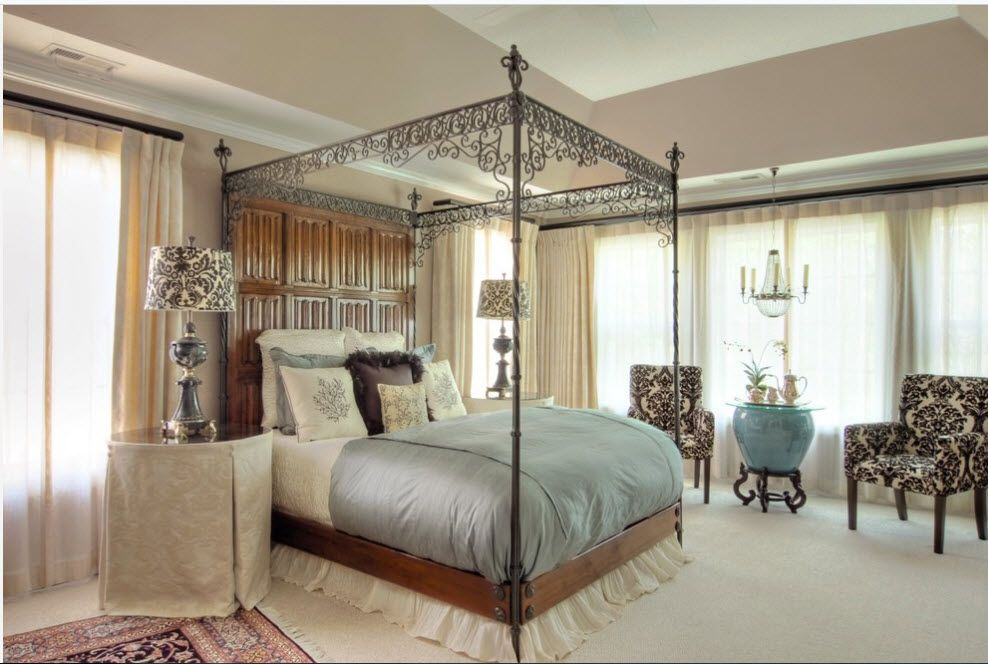 Wrought-iron Bed as a Stylish and Functional Interior Element. Royal ambience for royal bed with forged canopy