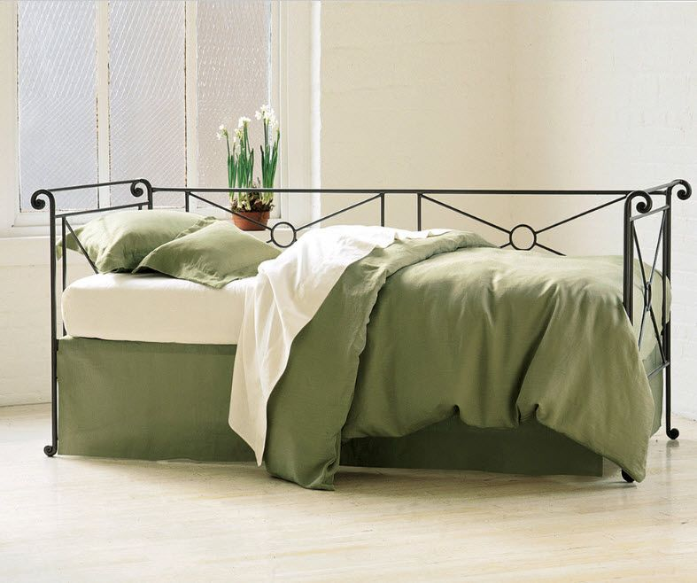Wrought-iron Bed as a Stylish and Functional Interior Element. Olive linens for the simple designed bed