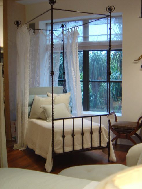 Wrought-iron Bed as a Stylish and Functional Interior Element. Classic style for the spacious house's room with restrained simple bed design