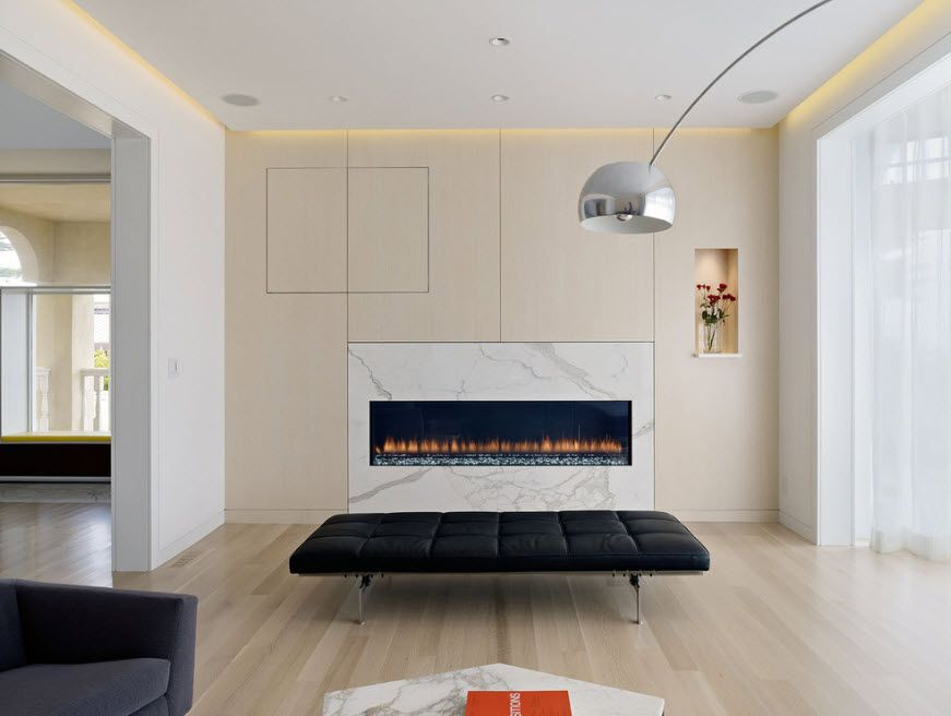 Futuristic and bewitching interior decoration for the modern living room with fireplace and ultrthin sofa