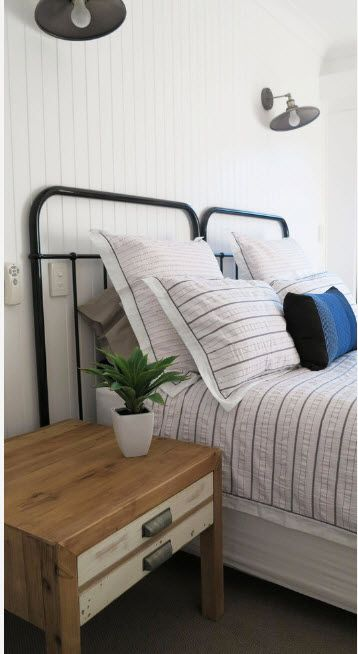 Paired bed with black metal frame