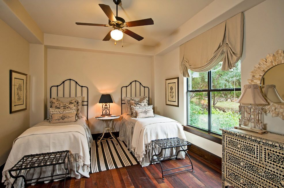 Wrought-iron Bed as a Stylish and Functional Interior Element. A pair of beds in the modern Mediterranean setting
