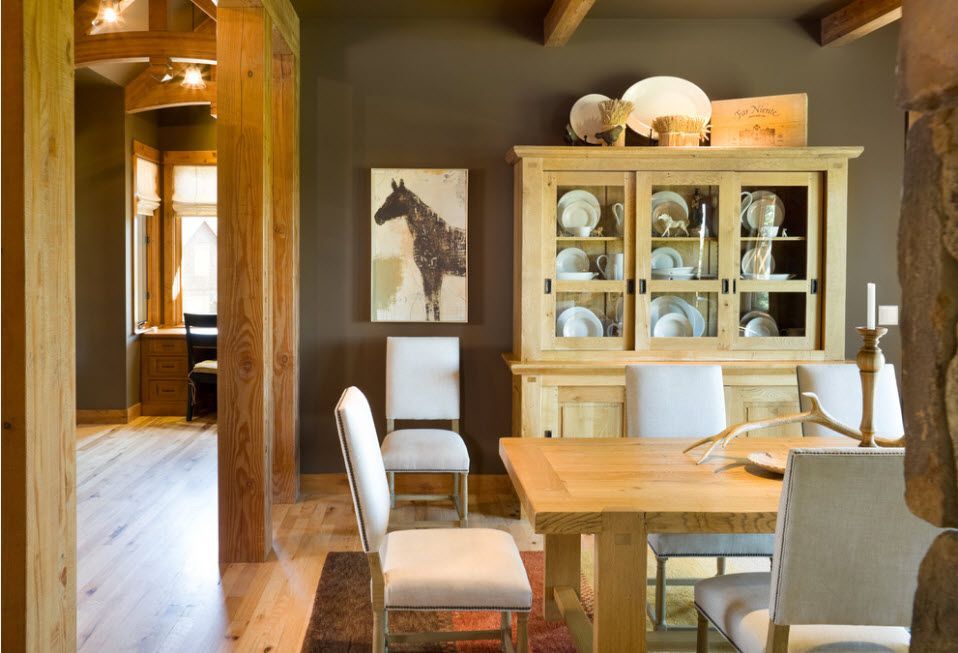 Unusual design in the Rustic kitchen with raw treated wooden furniture and columns