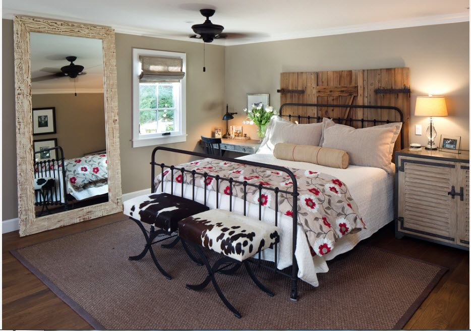 Wrought-iron Bed as a Stylish and Functional Interior Element. Striking rustic style with black bed frame and wooden headboard