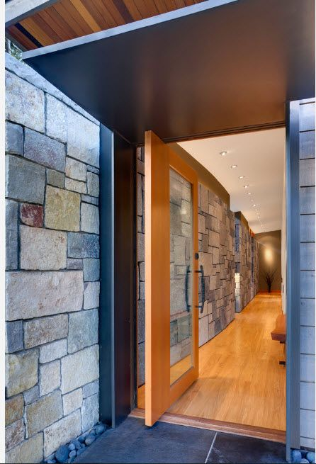 The Use of Decorative Stone for Modern Interiors' Finishing.  Big slabs of artificial material on the hall walls