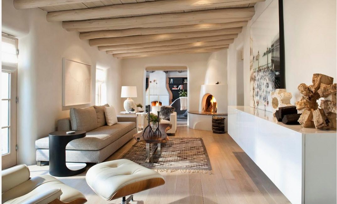 Bleached Oak Color in Modern Interior Design. Open ceiling beams, open layout and Eames lounge chair in white leather