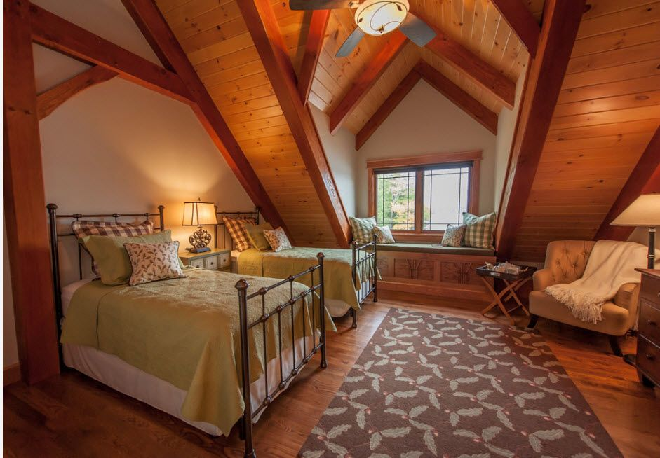 Wrought-iron Bed as a Stylish and Functional Interior Element. Large-scale loft room design with wooden inlays and open ceiling constructions