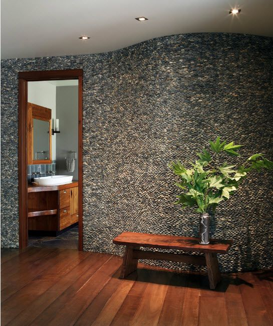 Pebble cladded figure walls in gray