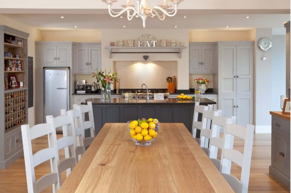 Large wooden table for the dining zone of the open layout kitchen