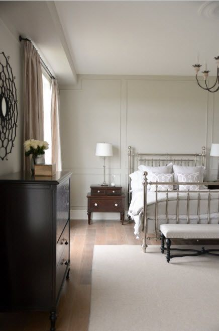 Wrought-iron Bed as a Stylish and Functional Interior Element. Classic air in the pastel colored light room