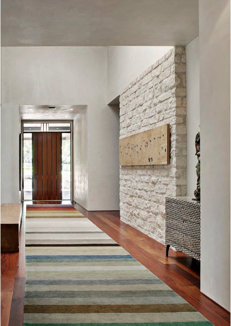 Whitewashed stone for the long narrow hall